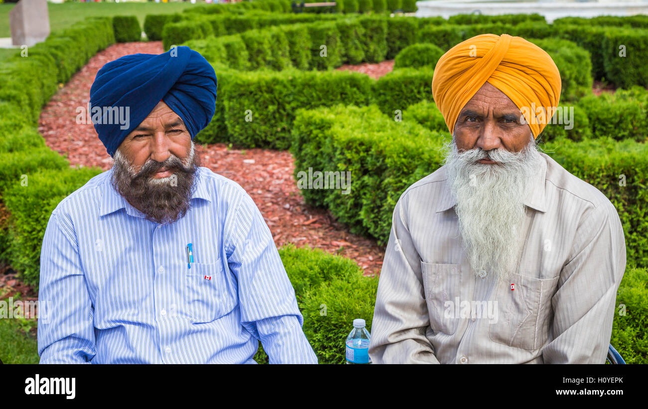 Two Indian men with turbans at Culture Fest 2016 held in the Bethel Heritage Park, Winkler, Manitoba, Canada. - Stock Image
