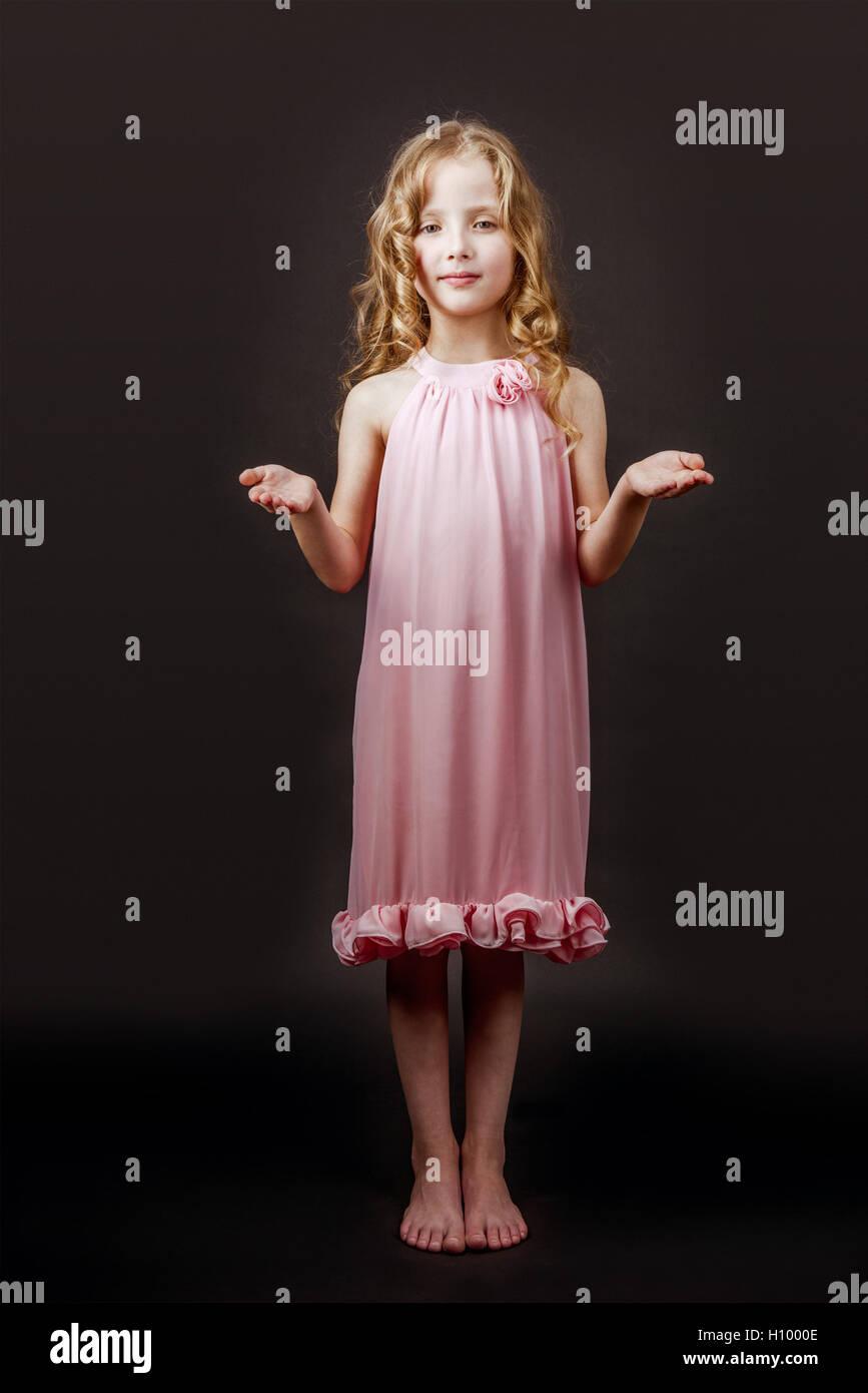 charming little girl on the black wall backdrop halloween