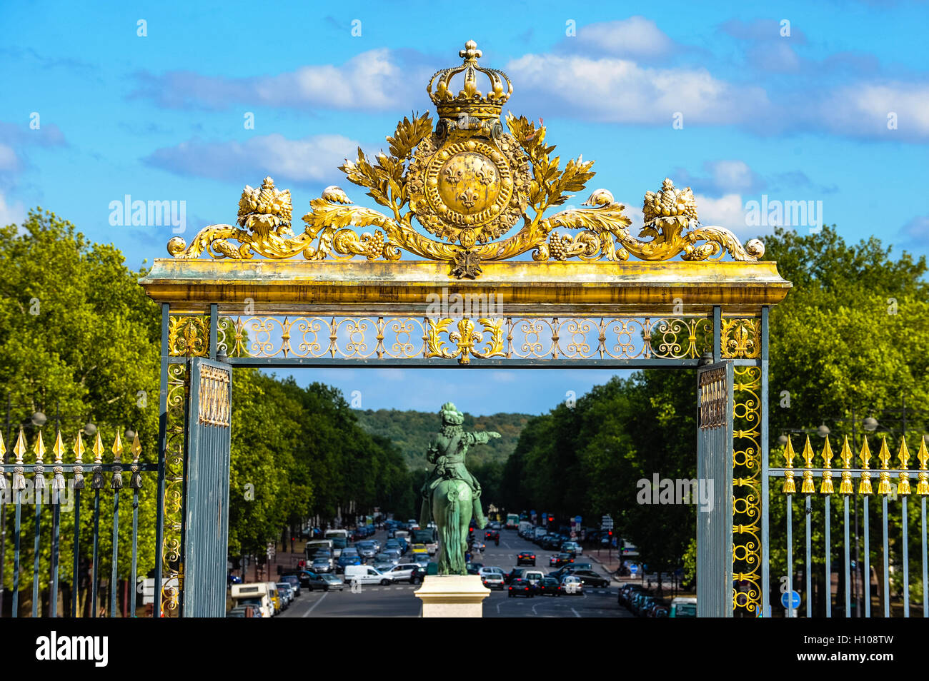 The Palace of Versailles, or simply Versailles, is a royal château close to Paris, France. Equestrian statue - Stock Image