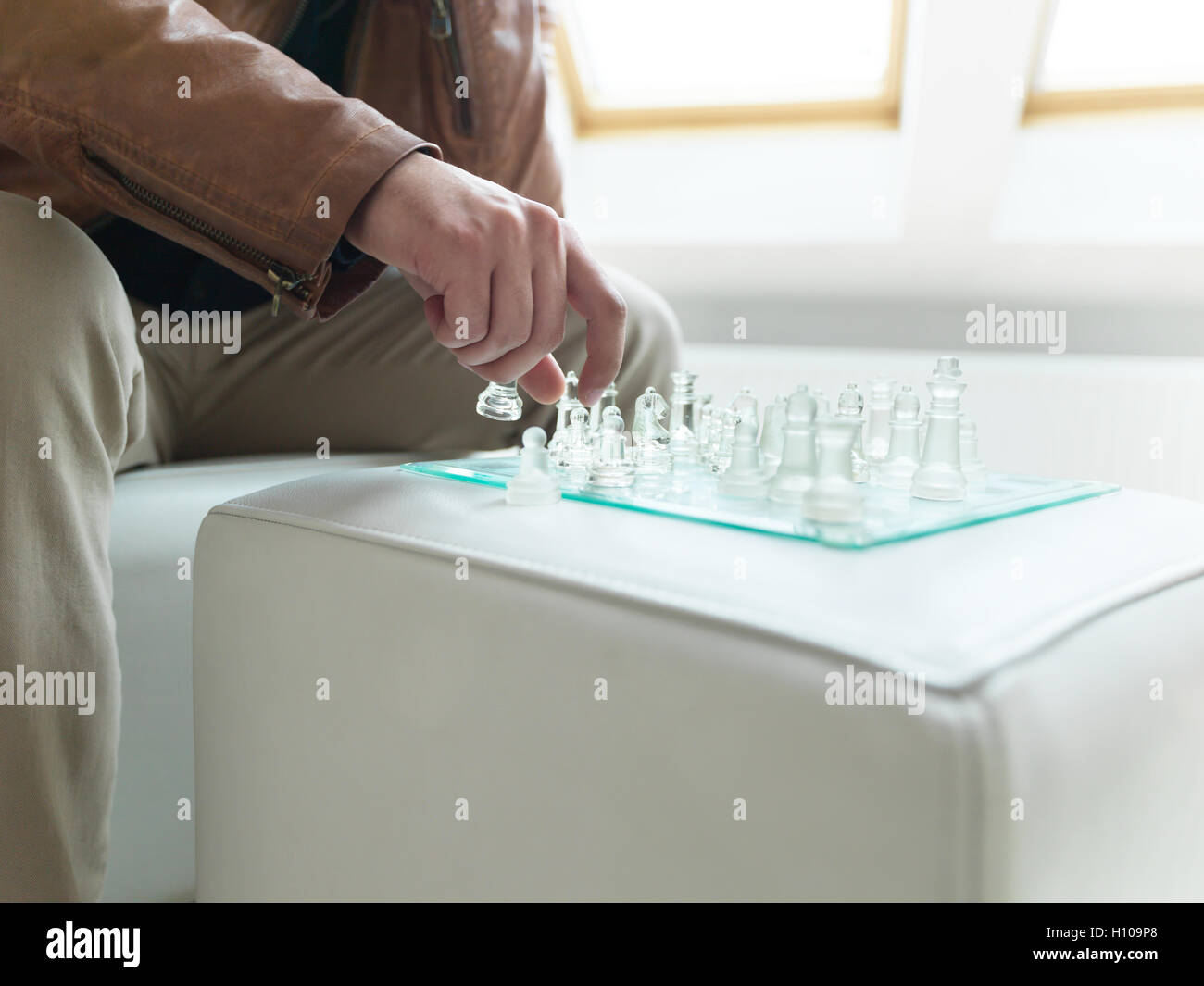 Close-up of player's hand executing his winning move - Stock Image