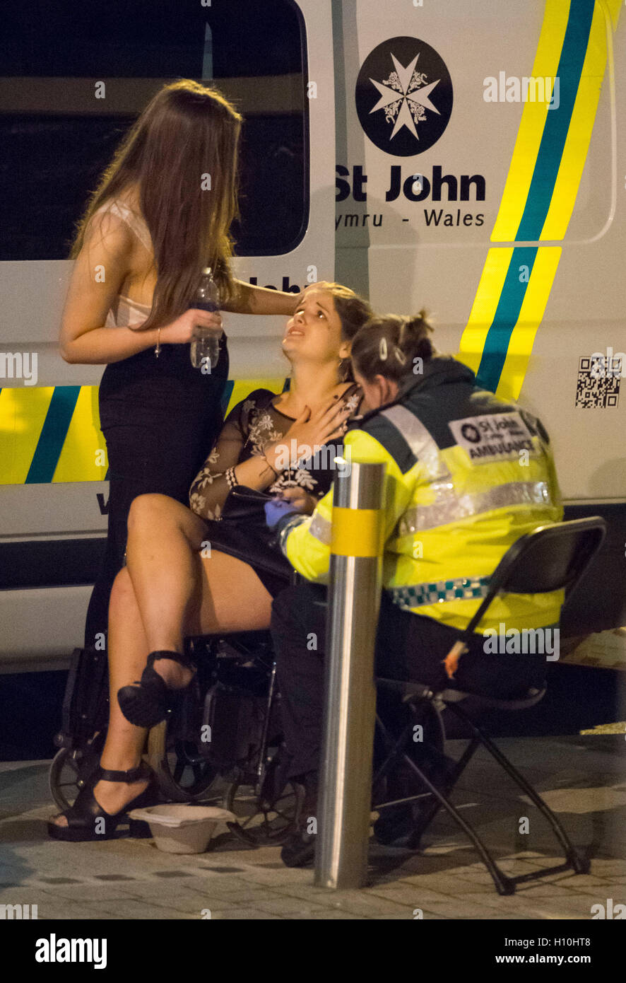 St. John Ambulance crew help a woman outside a nightclub during Freshers week in Cardiff, South Wales. - Stock Image