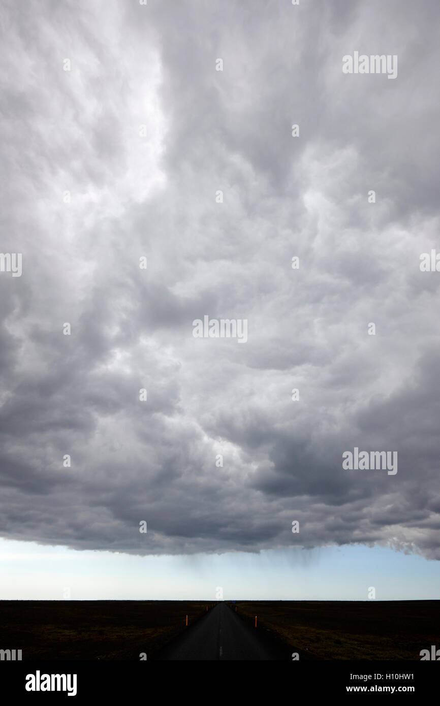 frontal cloud formation over vast volcanic ash flats Iceland - Stock Image