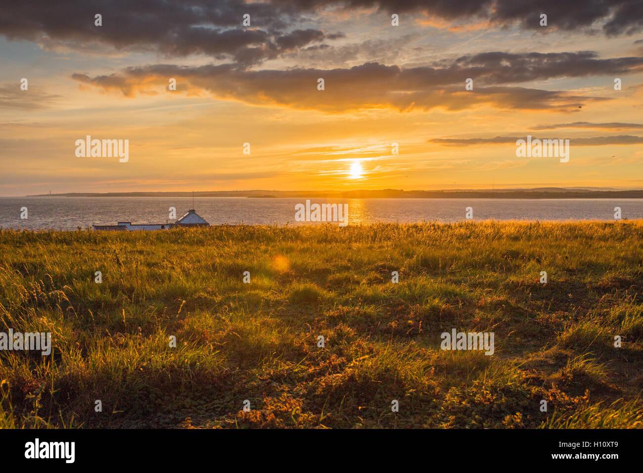 Flat Holm Island Farmhouse at sunset. - Stock Image