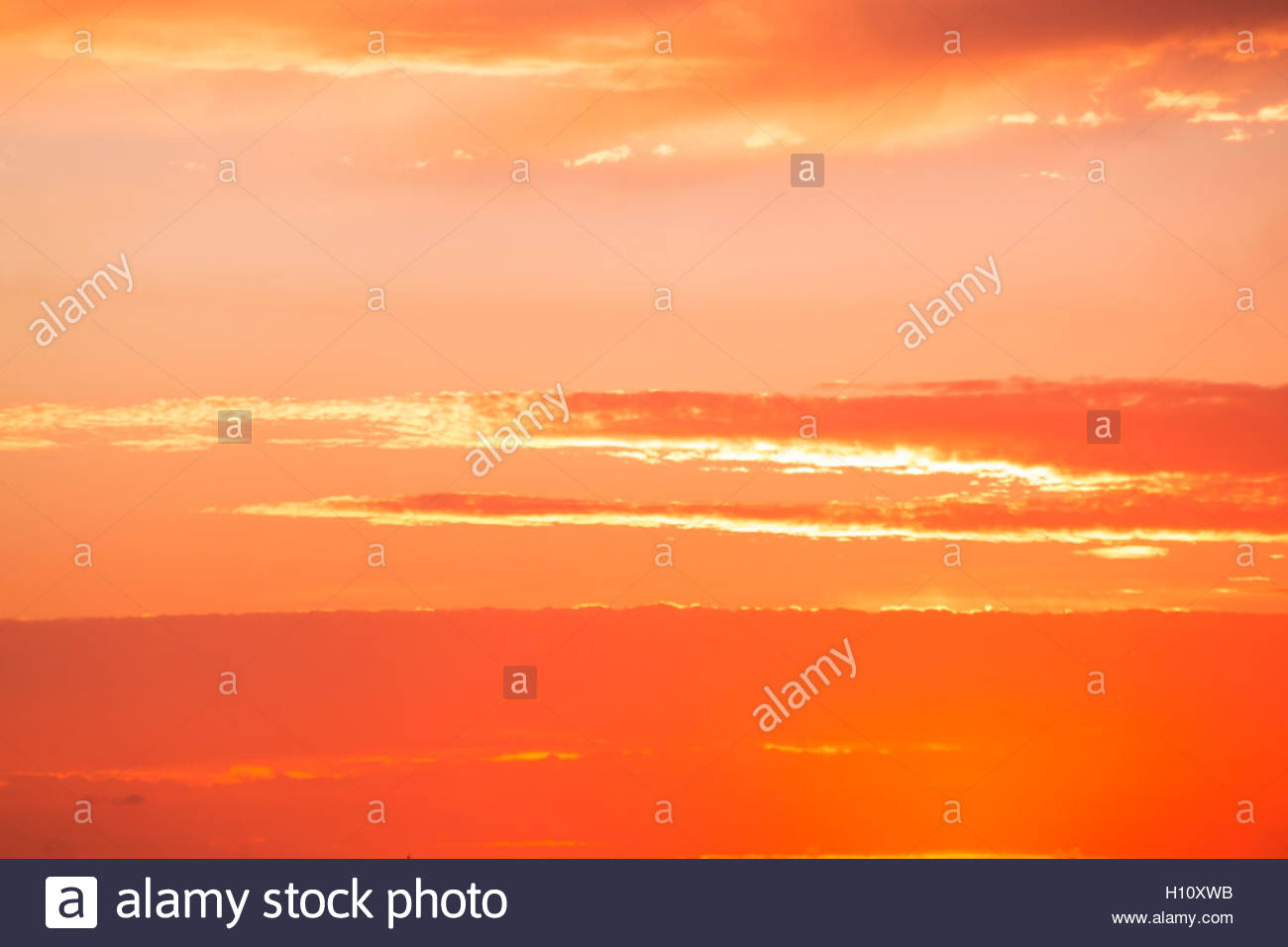 Bright orange sky - Stock Image