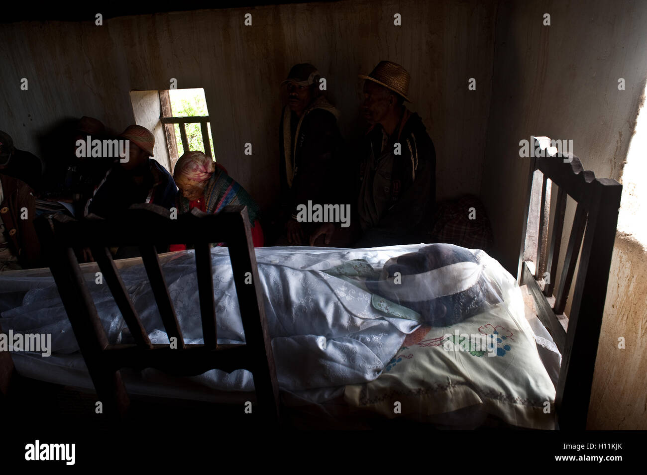 Dead body of an old woman in funeral held + bereaved relatives ( Madagascar) - Stock Image