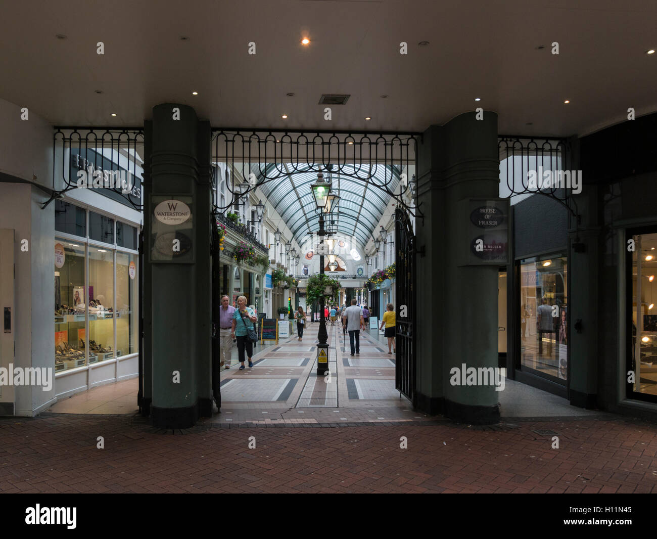 Bournemouth Arcade St Peter's Road Dorset England UK provides undercover shopping with glass covered walkway - Stock Image
