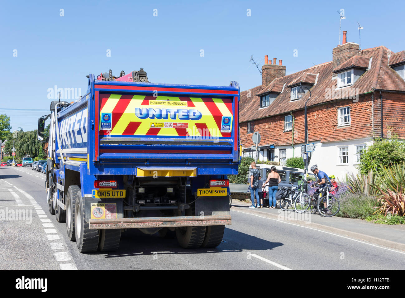 Heavy truck passing through small village, High Street, Bletchingley, Surrey, England, United Kingdom - Stock Image
