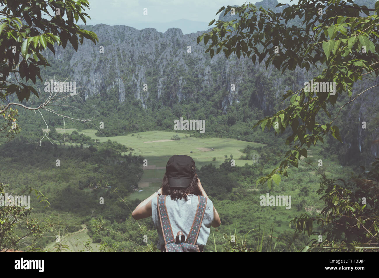 Woman backpacker shoot photo in nature background. - Stock Image