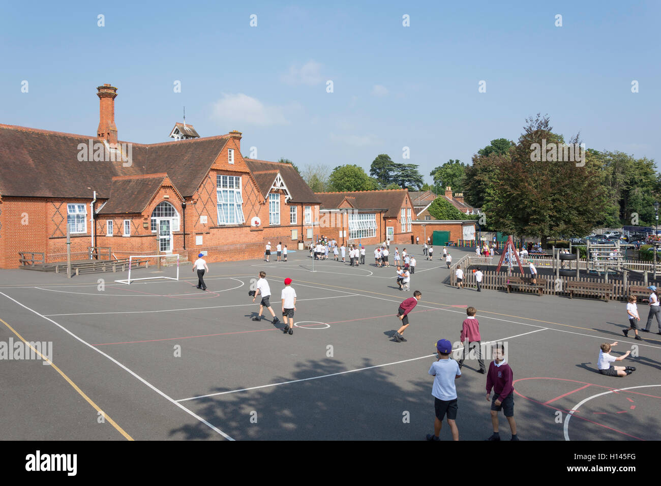 Children in playground, St Michael's Church of England Primary School, High St, Sunninghill, Berkshire, England, - Stock Image