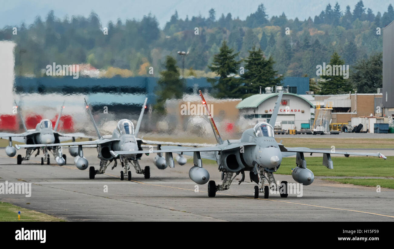 CF-18A Hornet fighter jets of the Royal Canadian Air Force taxi along the tarmac at Vancouver International Airport, - Stock Image