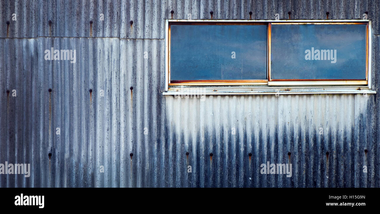 Grunge Old Galvanized Sheet Wall with Glass Window - Stock Image