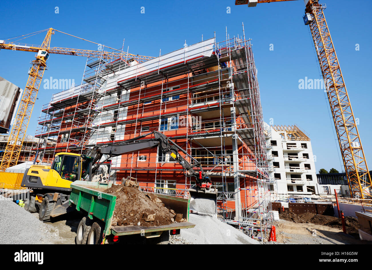 large construction plant, cranes and scaffolding - Stock Image