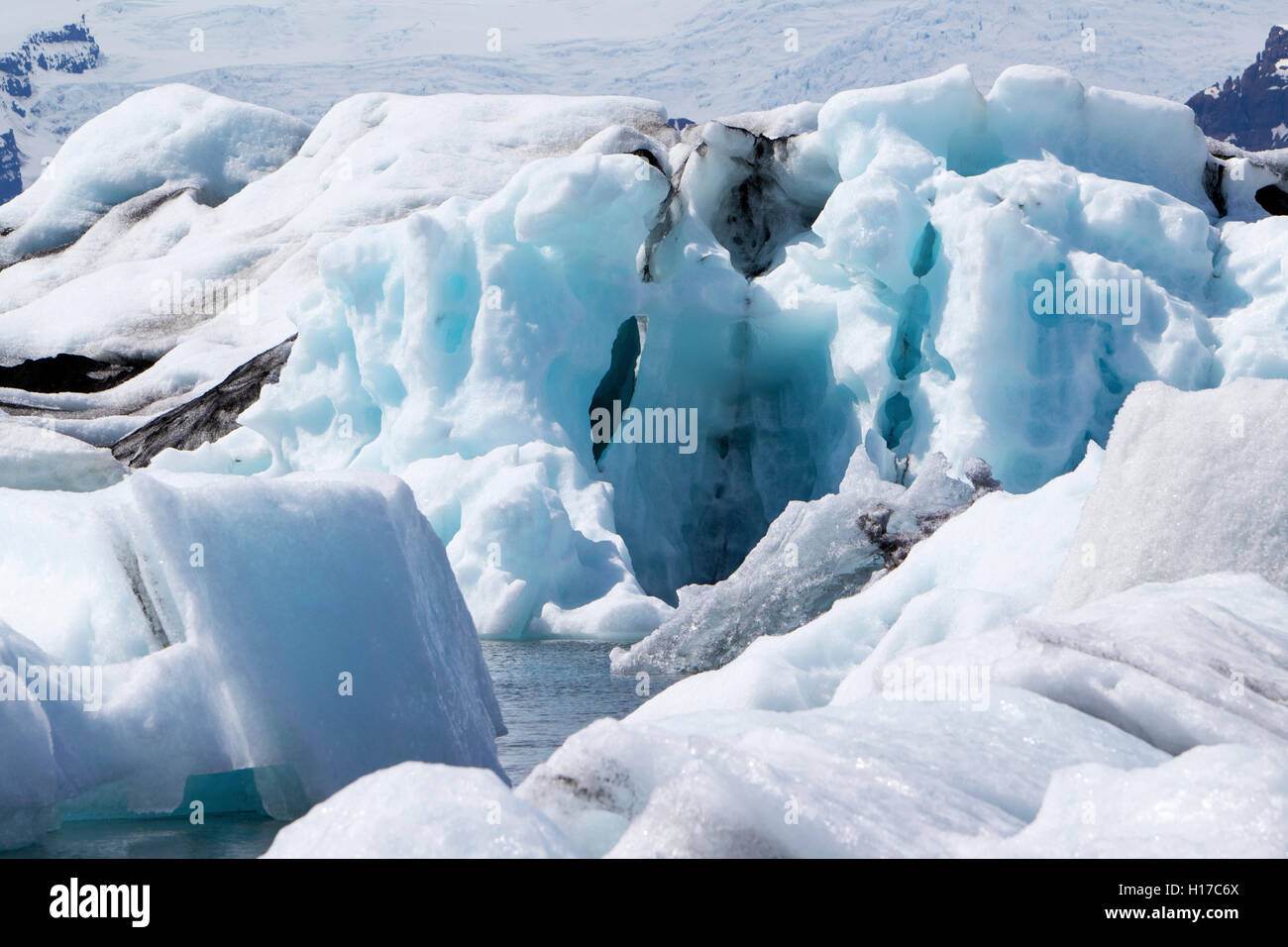 wind blown and sculpted icebergs at Jokulsarlon glacial lagoon Iceland - Stock Image