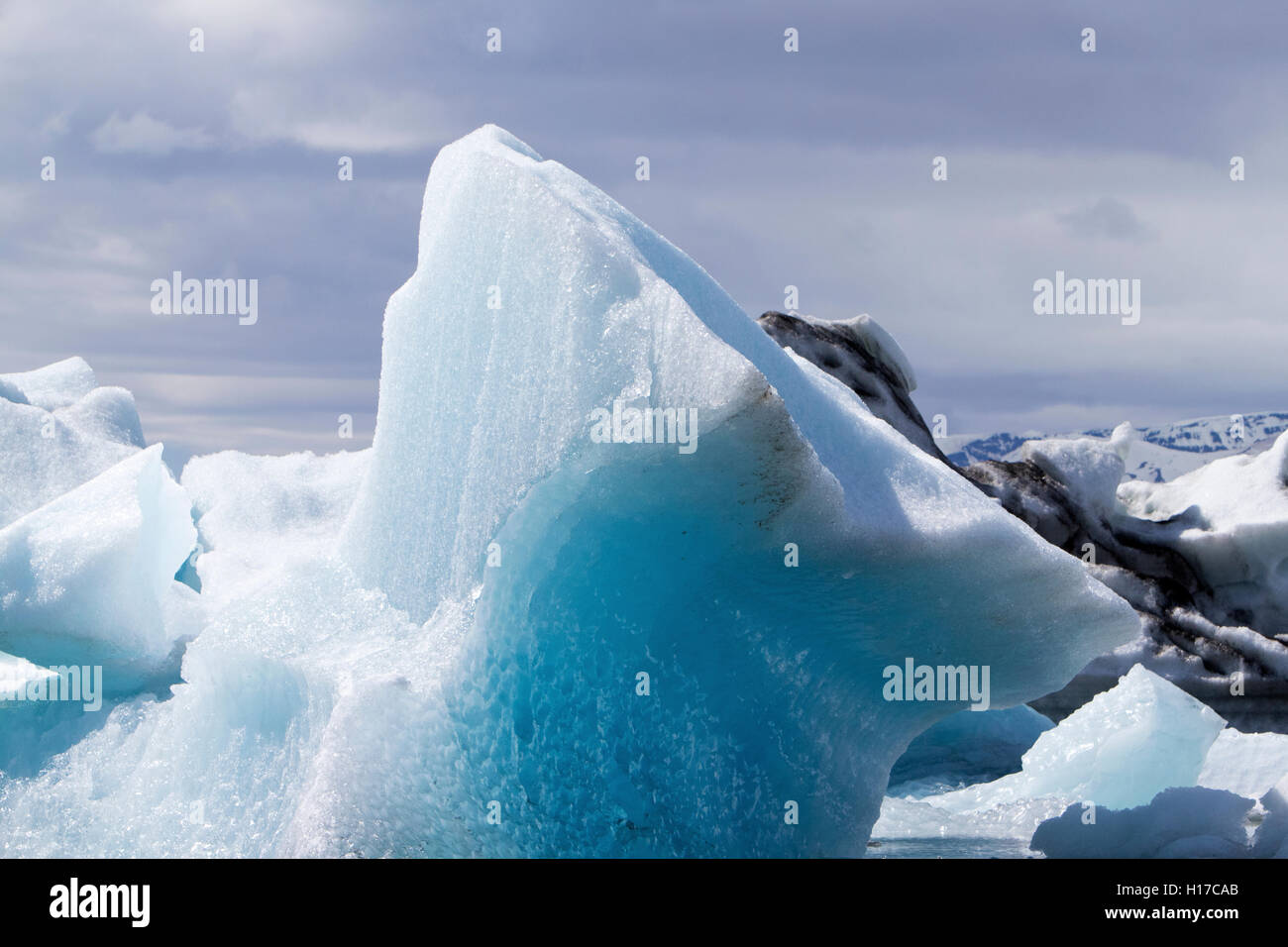 wind and water sculpted iceberg at Jokulsarlon glacial lagoon Iceland - Stock Image
