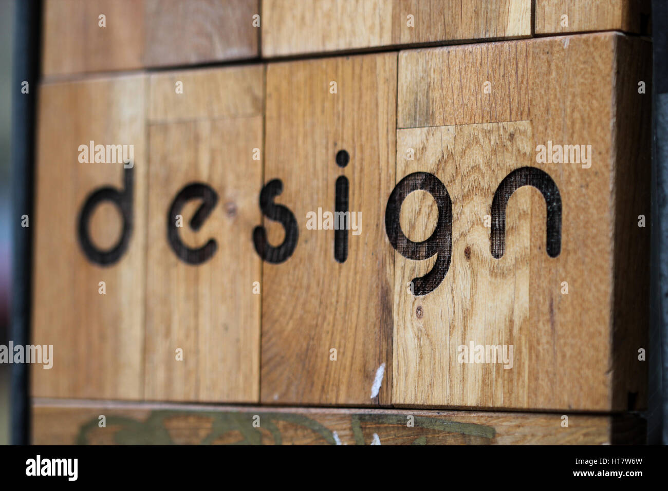 Wooden surface with word design on it - Stock Image