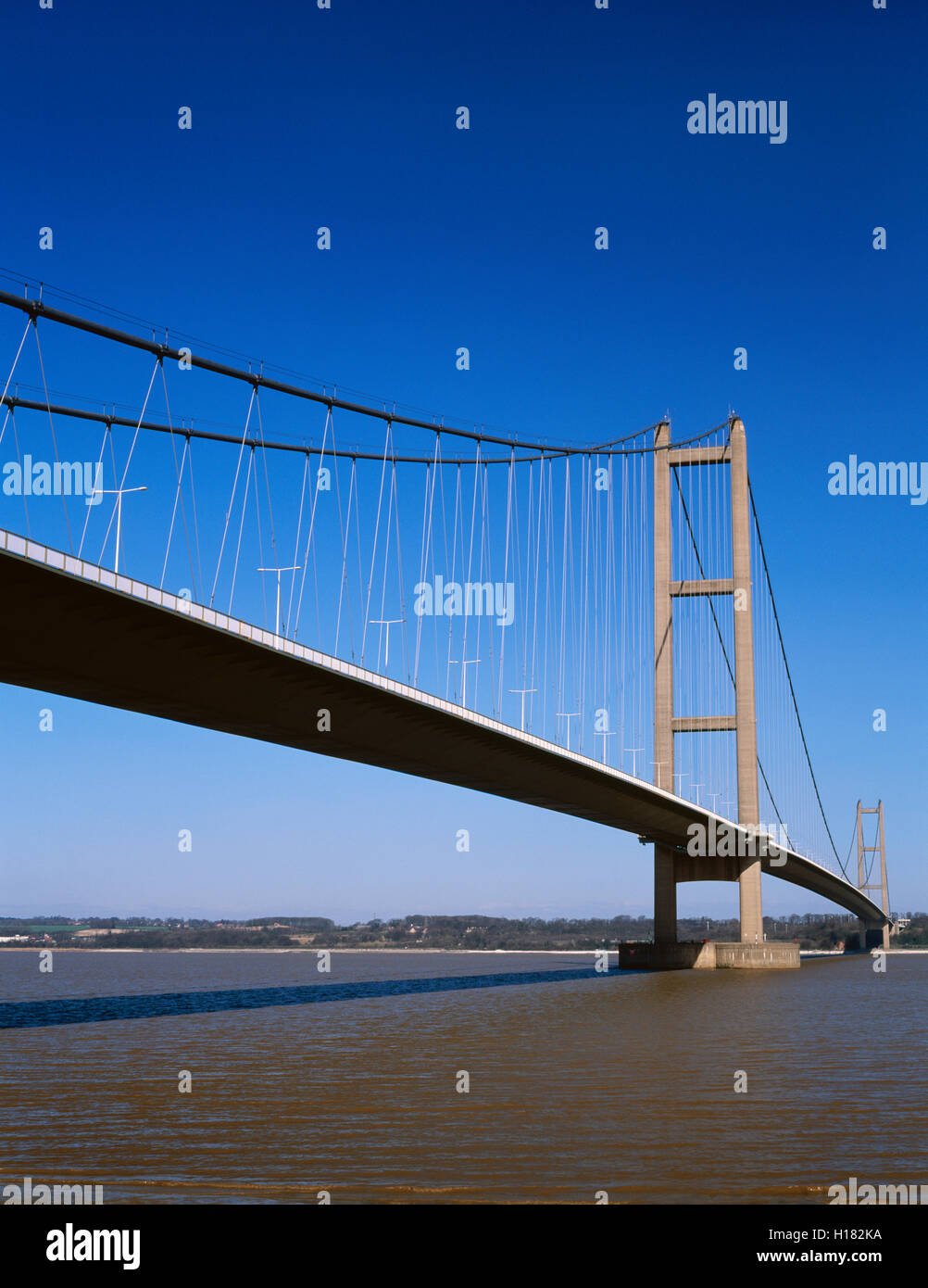 The Humber Bridge from the shore near Barton upon Humber. North Lincolnshire, England, UK; suspension bridge - Stock Image