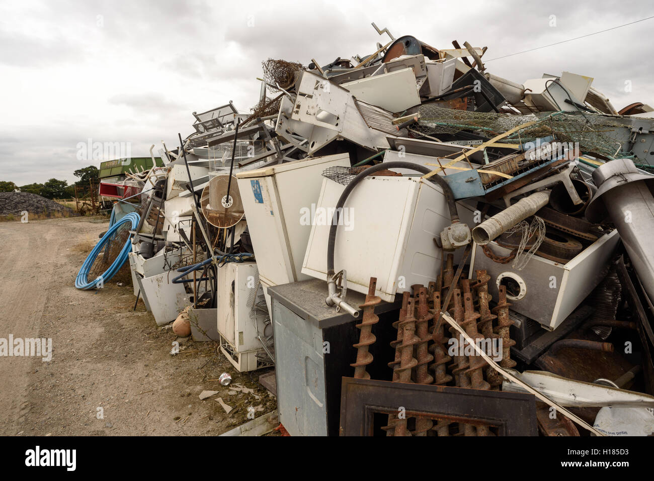 Piles of scrap metal and kitchen goods collected at a scrap yard for recycling Stock Photo
