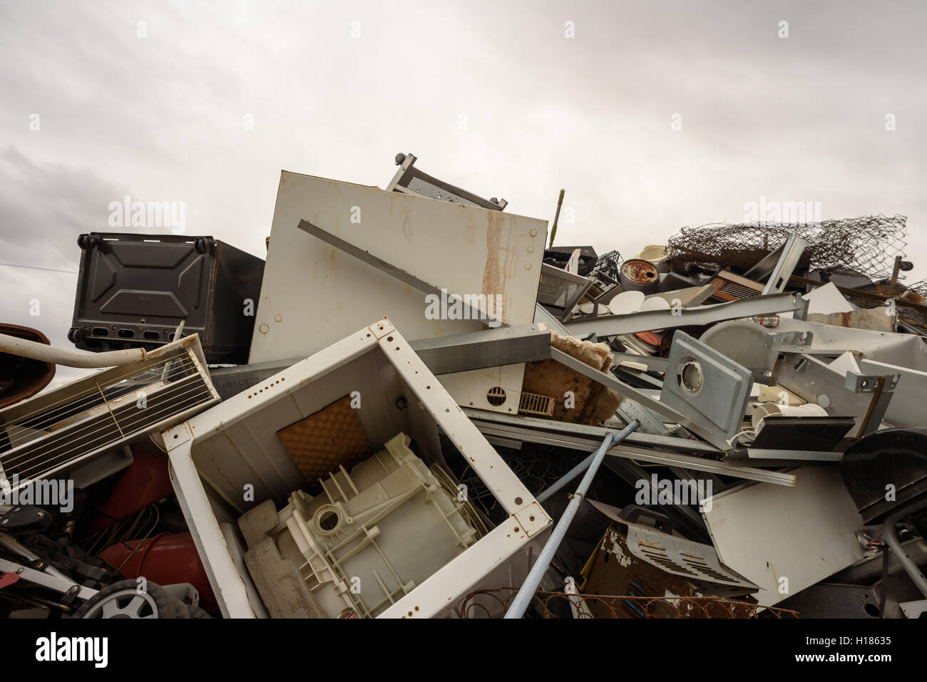 Scrap metal pile with home appliances and white goods collected for recycling. - Stock Image