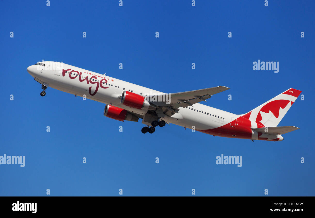 Air Canada Rouge Boeing 767-300ER taking off from El Prat Airport in Barcelona, Spain. Stock Photo