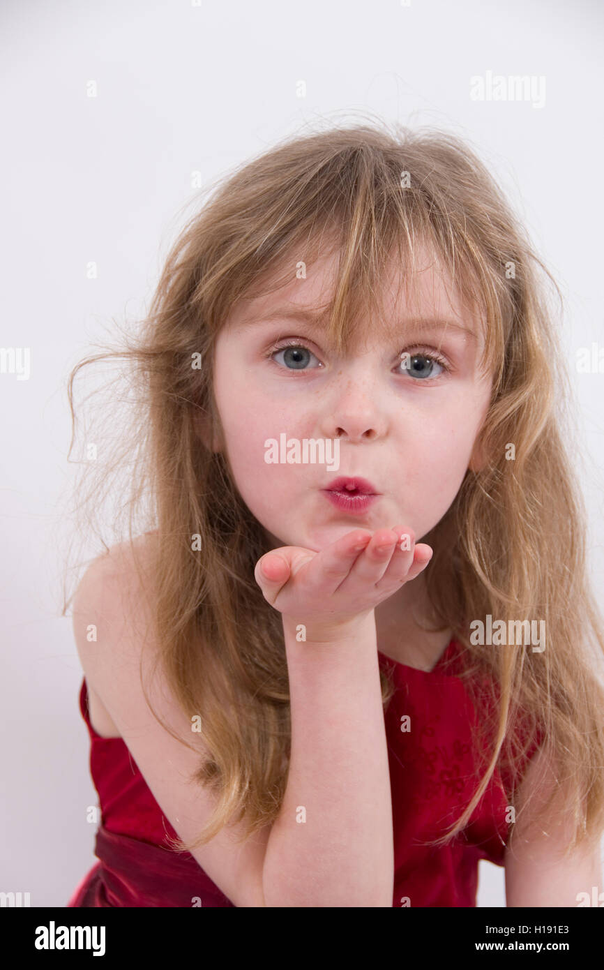 ad75c5324ed6 Blowing a Kiss : Beautiful blond 6 year old girl wearing a shiny red  evening dress