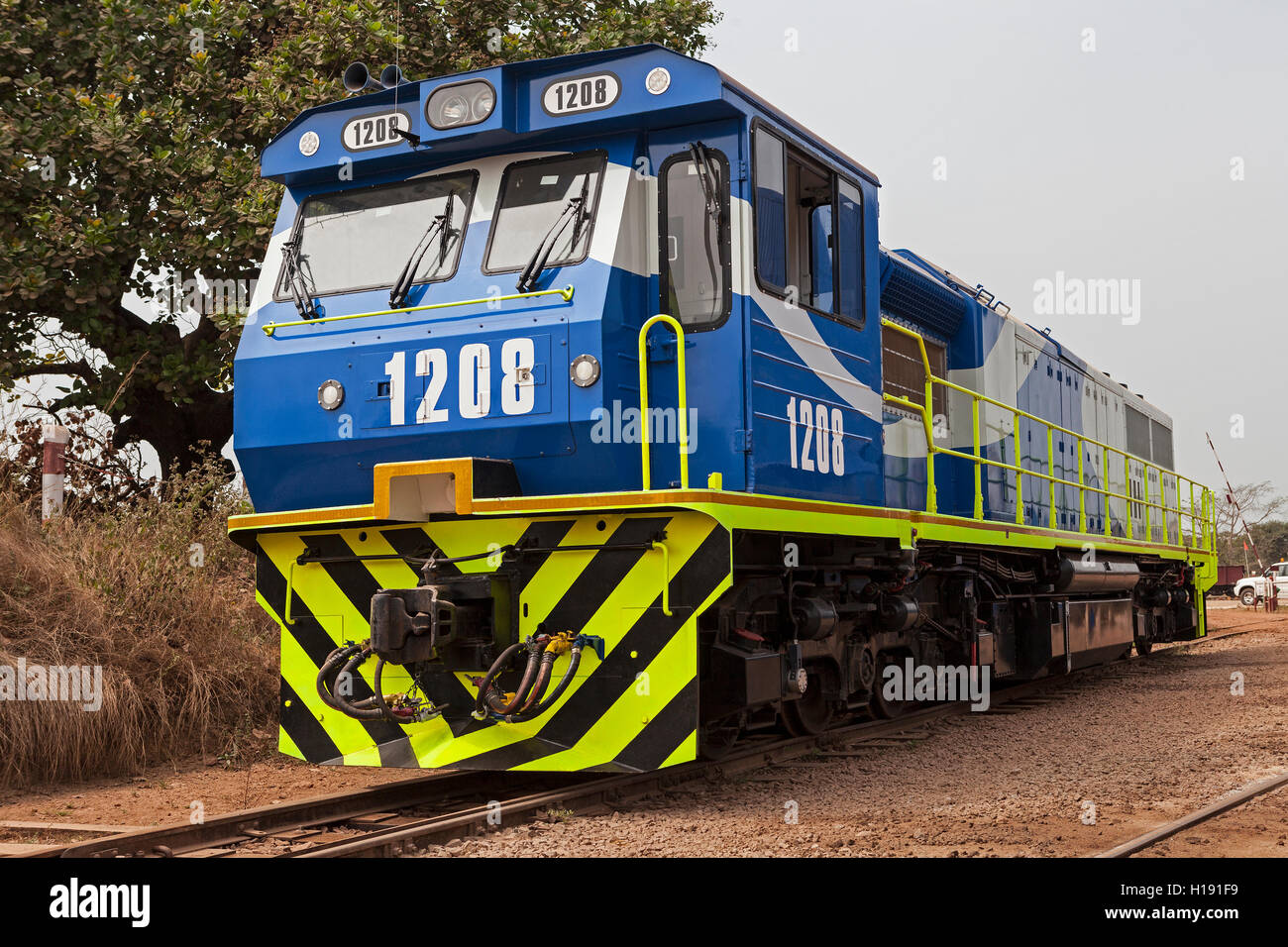 Operations for transporting and managing iron ore. New locomotive added to the fleet used to pull full iron ore - Stock Image