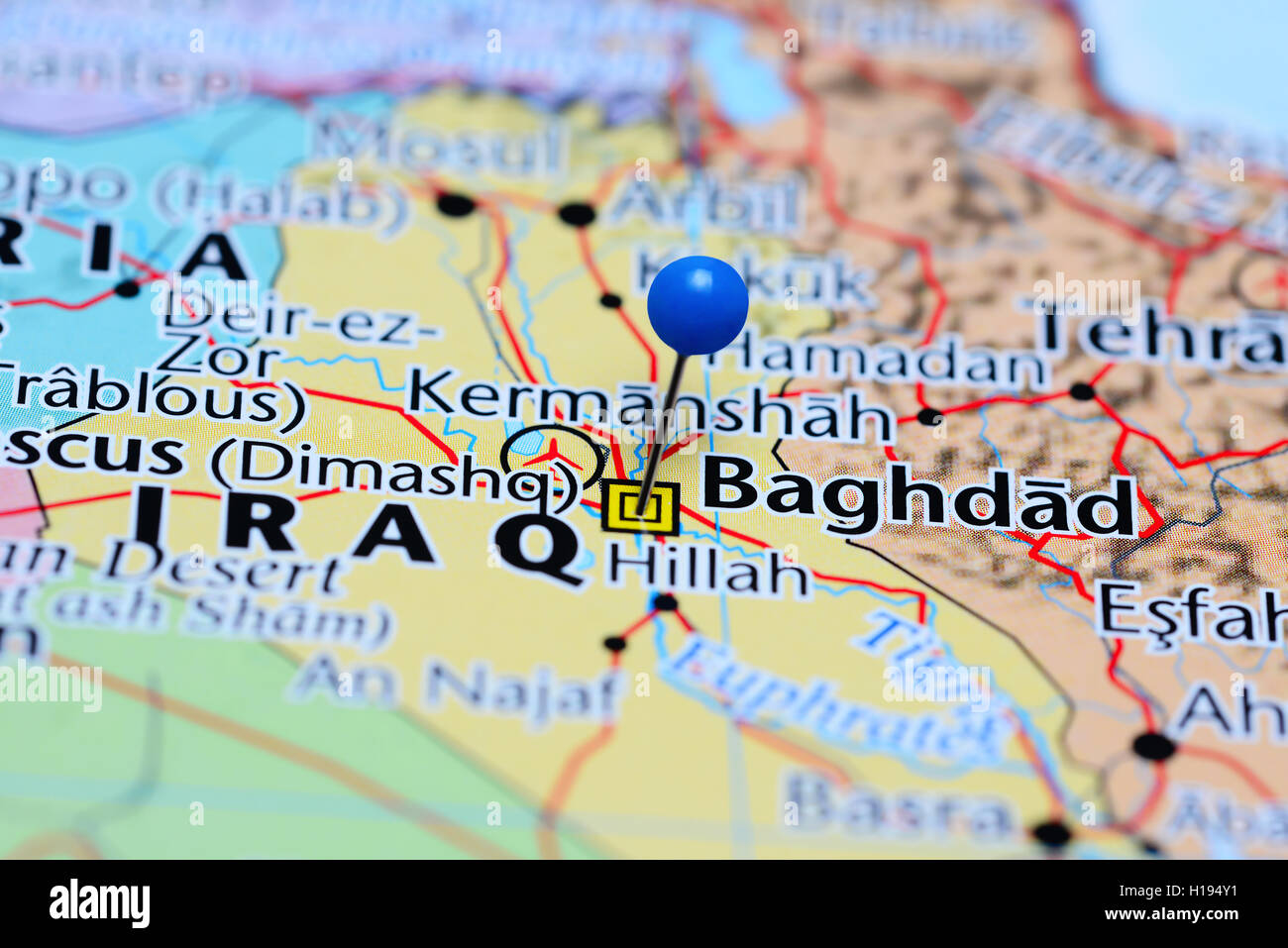 baghdad pinned on a map of iraq stock image