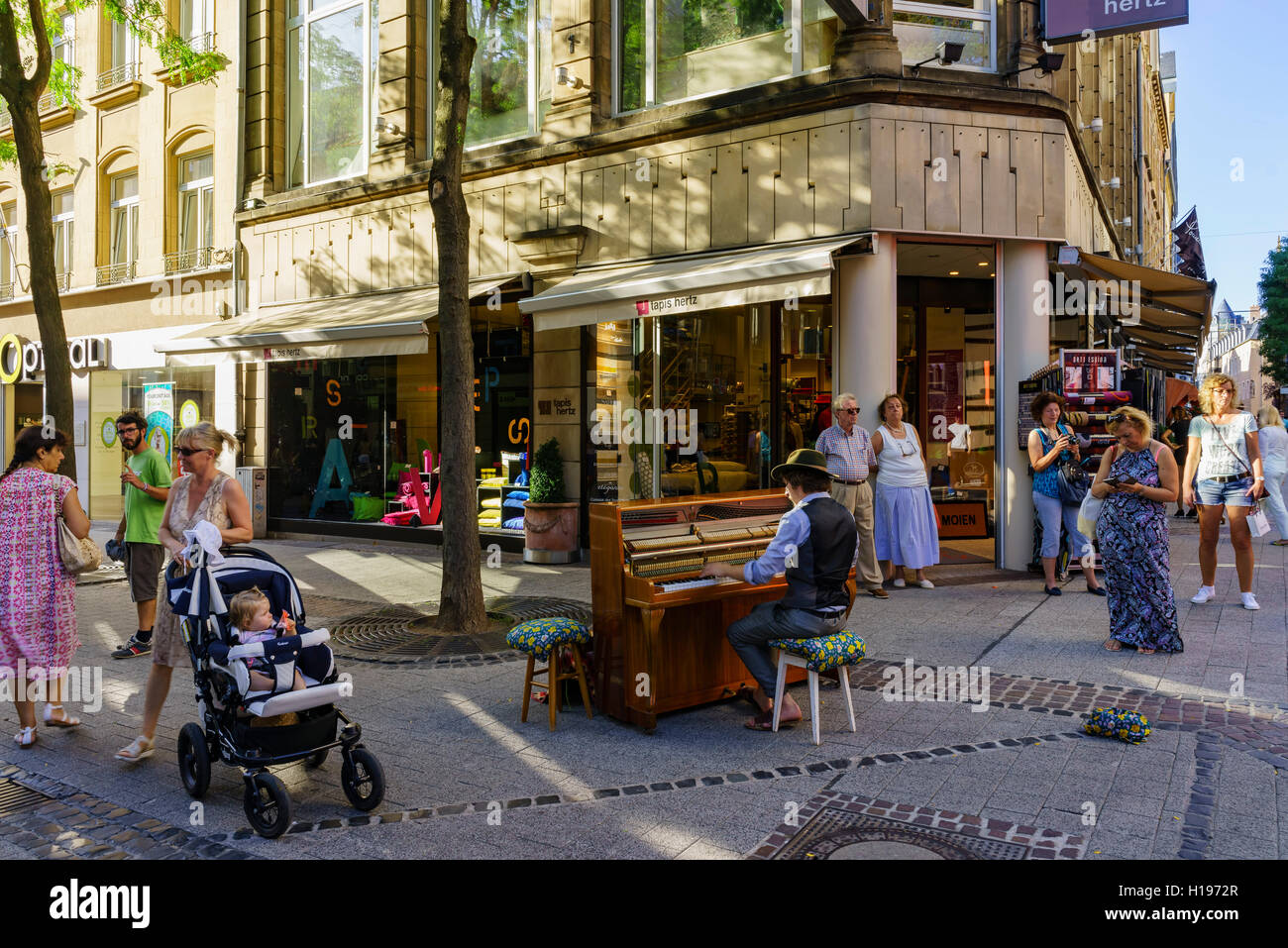 Luxembourg, SEP 10: Street artist playing piano with passers on SEP 10, 2016 at Luxembourg - Stock Image