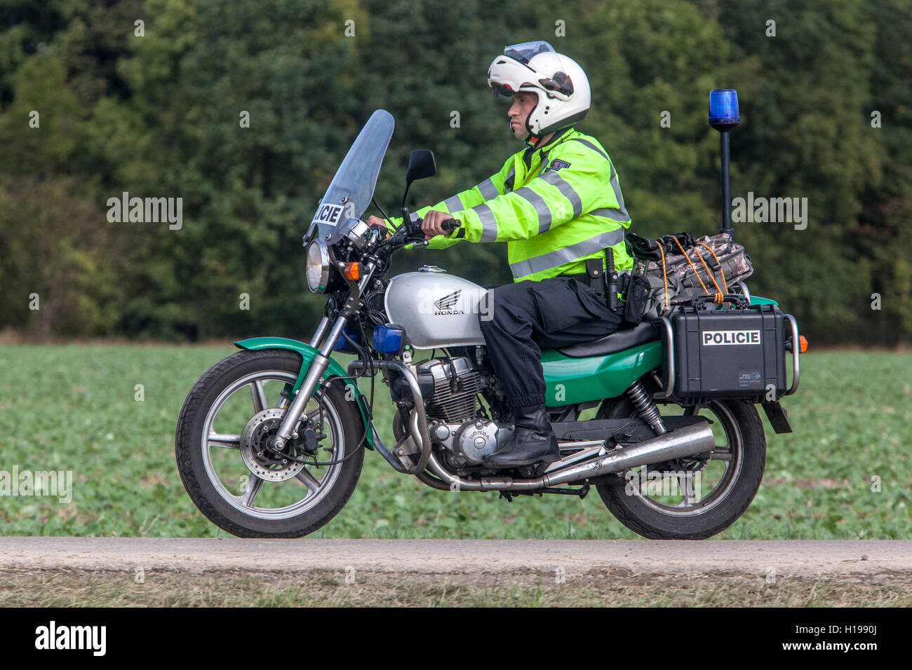 Czech police,  policeman on motorbike - Stock Image