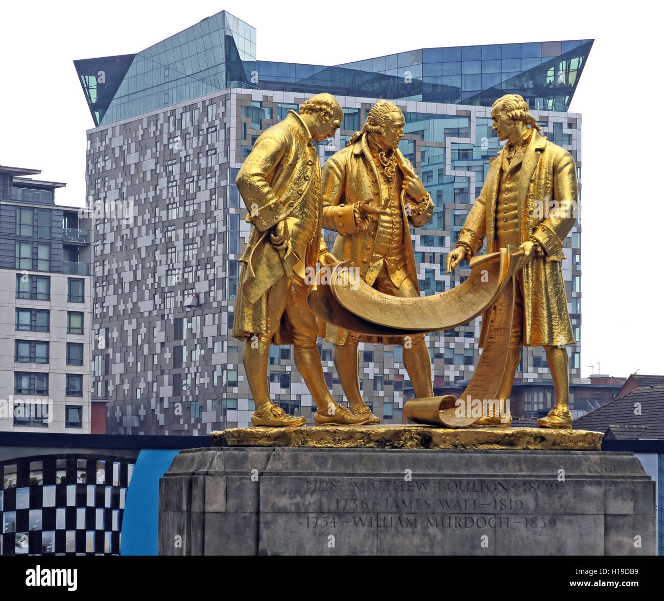 Matthew Boulton, James Watt and William Murdoch, gold statue, by William Bloye and Raymond Forbes-Kings , Broad - Stock Image