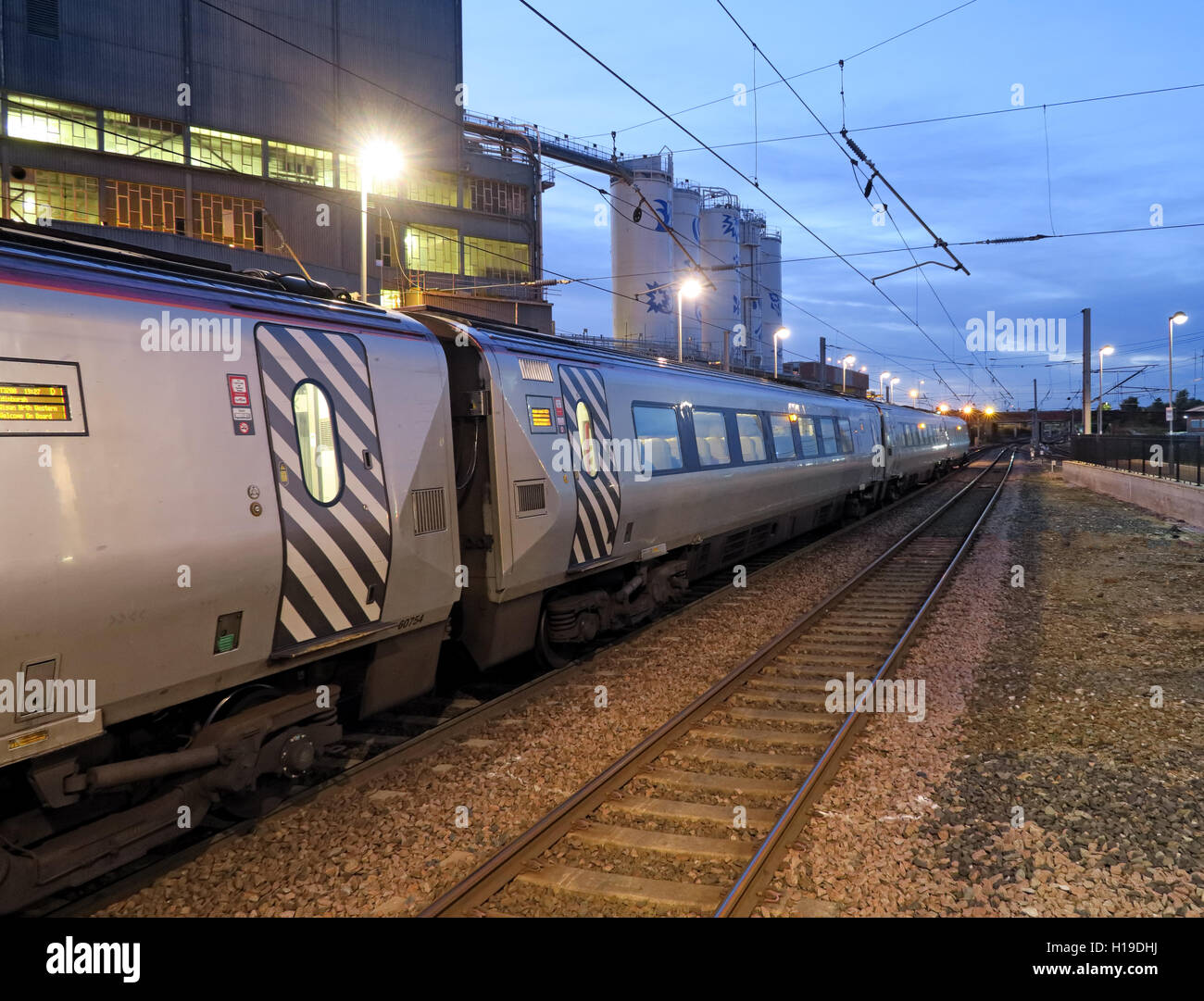 WCML Virgin Pendolino electric train,at Warrington bank Quay railway station, Northbound, Cheshire, England, UK - Stock Image