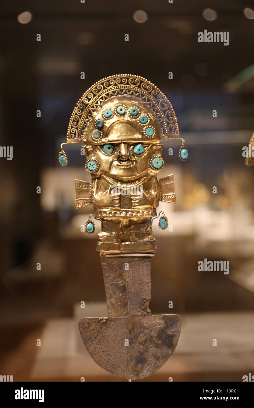 Ceremonial Knife. Peru. Sican (Lambayeque culture). 9th-11th century. Hammered gold and  turquoise inlay. - Stock Image