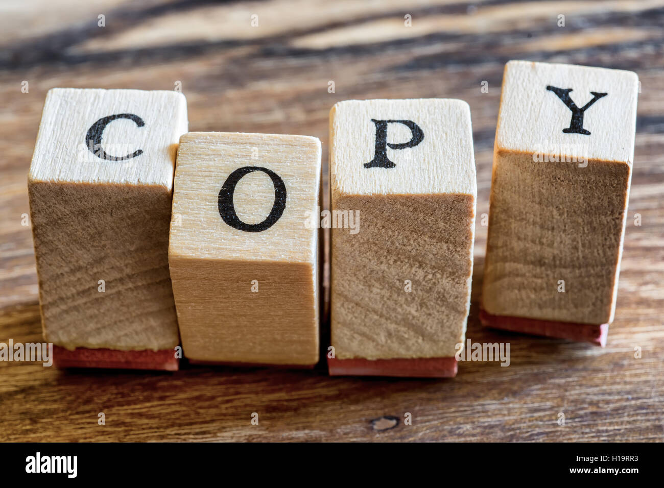 Copy Stamp on Woden Background. Copy Word Written in Wood Blocks. - Stock Image