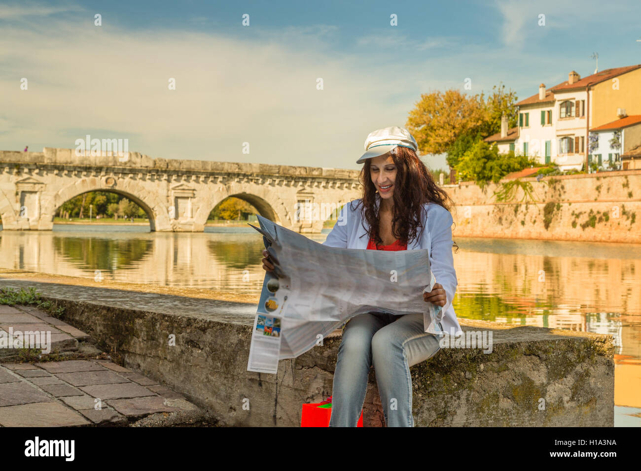 Rimini Italy Woman Consulting Tourist Map With Ancient Roman