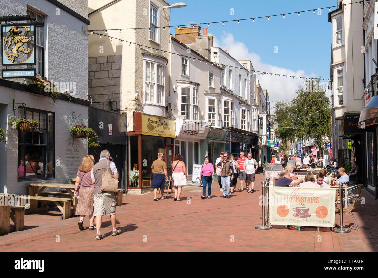 Busy street scene on pedestrian shopping precinct in town centre. St Mary Road, Melcombe Regis, Weymouth, Dorset, - Stock Image