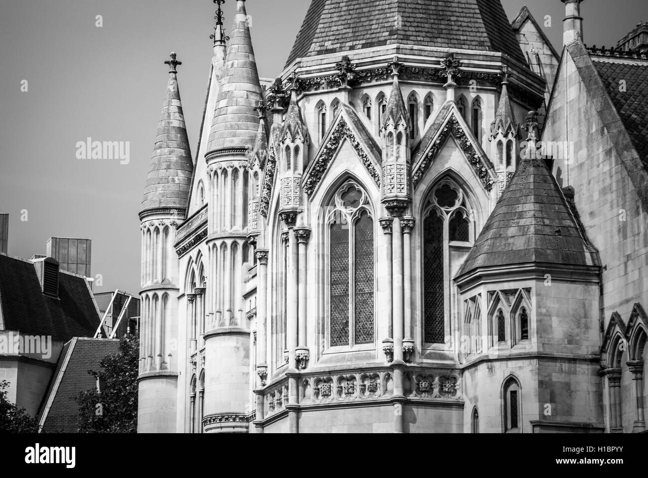 London's Royal Courts of Justice in the Strand, London. The building was designed by George Edmund Street and - Stock Image