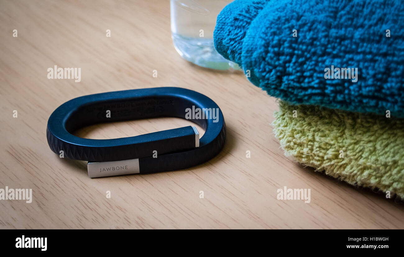 LONDON, UK - 24 MAY 2014: Photo of a black fitness UP band by Jawbone lying on a table, photographed on 24th May - Stock Image