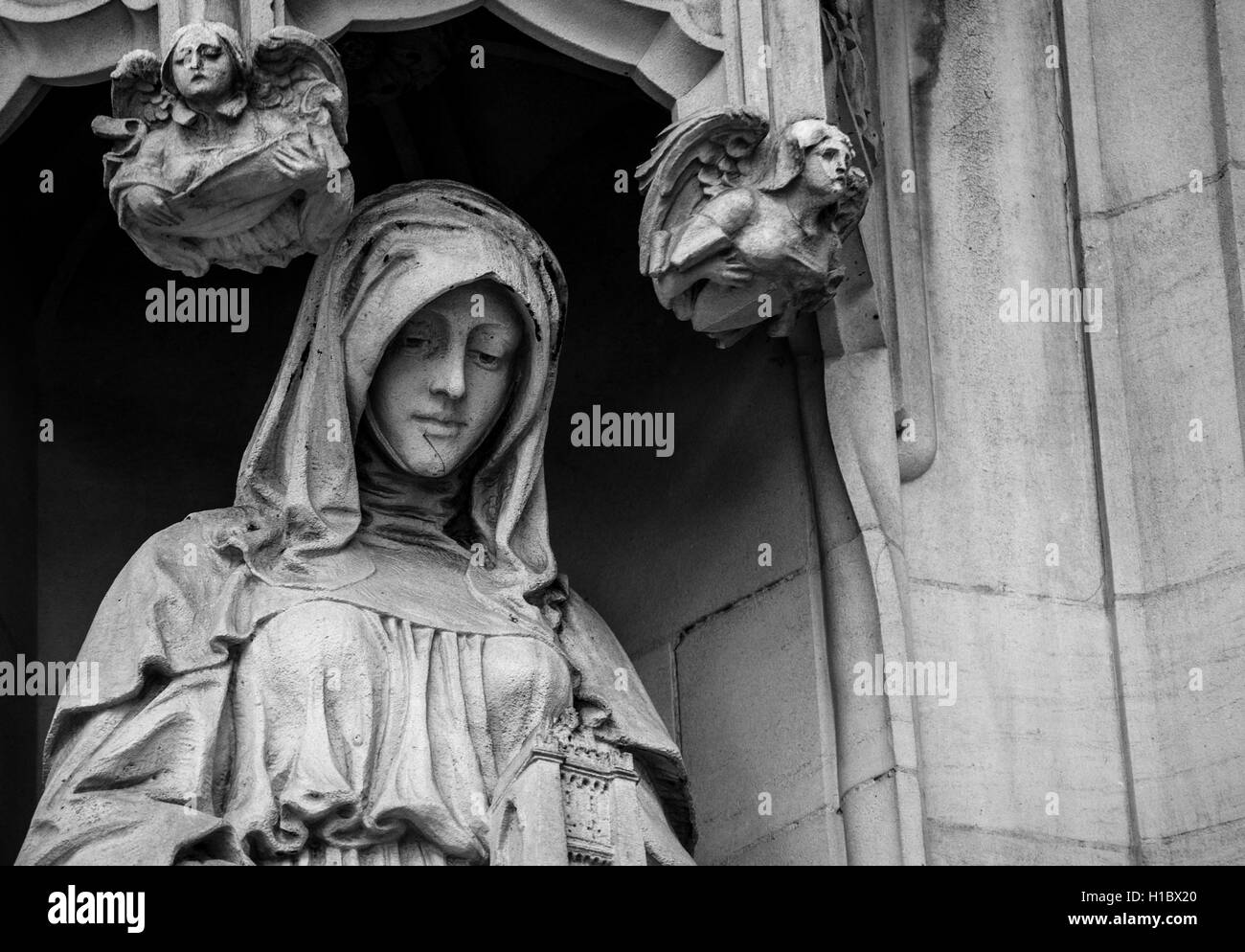 LONDON, UK - MAY 25, 2014: Beautiful lady statue on the wall of the Supreme Court in London, UK. Processed in black - Stock Image