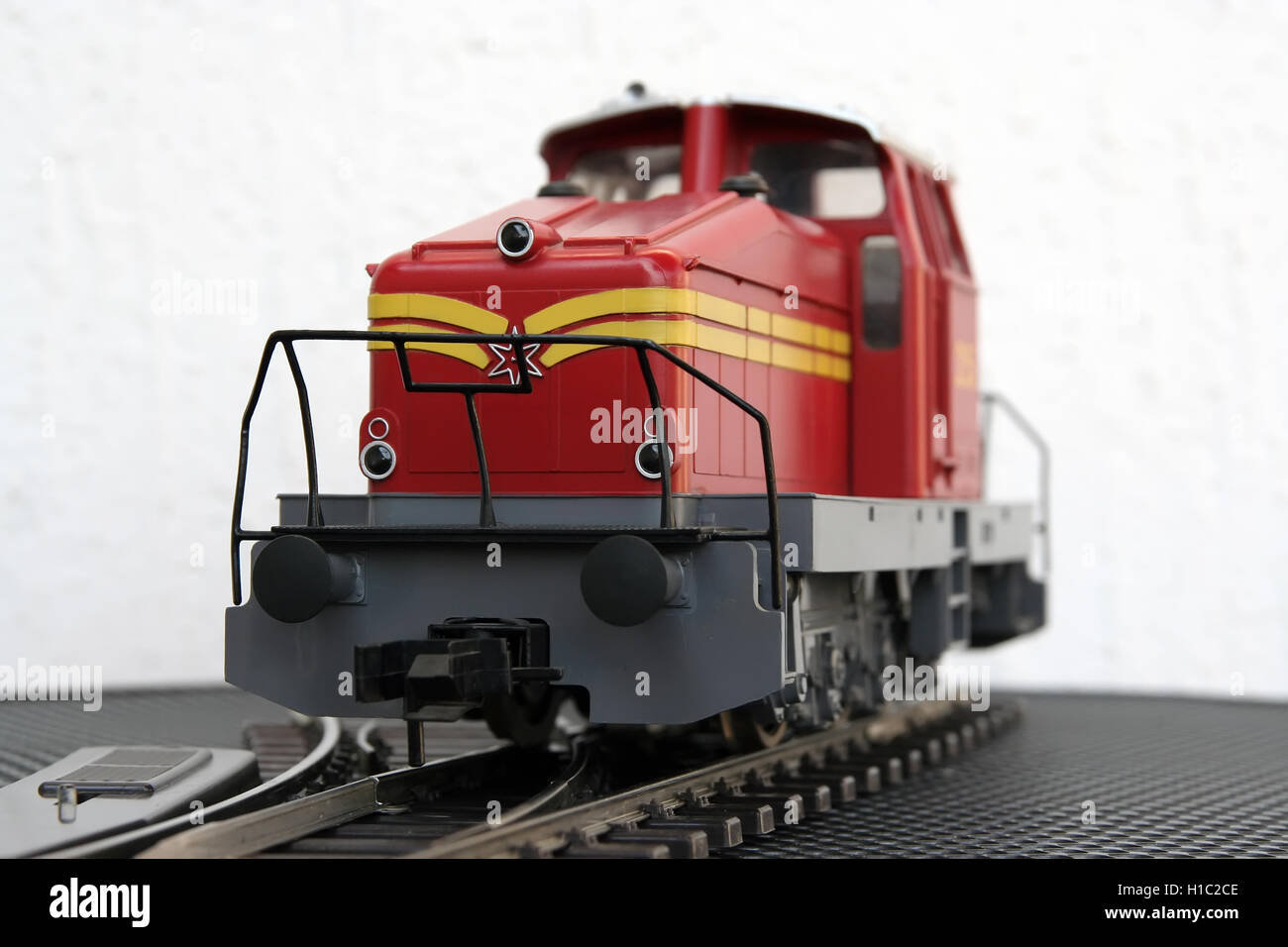 Red Locomotive miniature model. Red locomotive toy model. Stock Photo