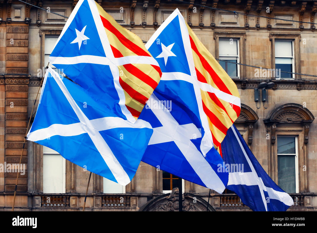 Scottish Saltire flag being flown with the Catalonian national flag as a sign of mutual support at a SNP independence - Stock Image