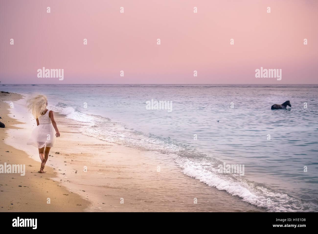beach, running, horse, sunset, Gili, Bali, romanticwoman - Stock Image
