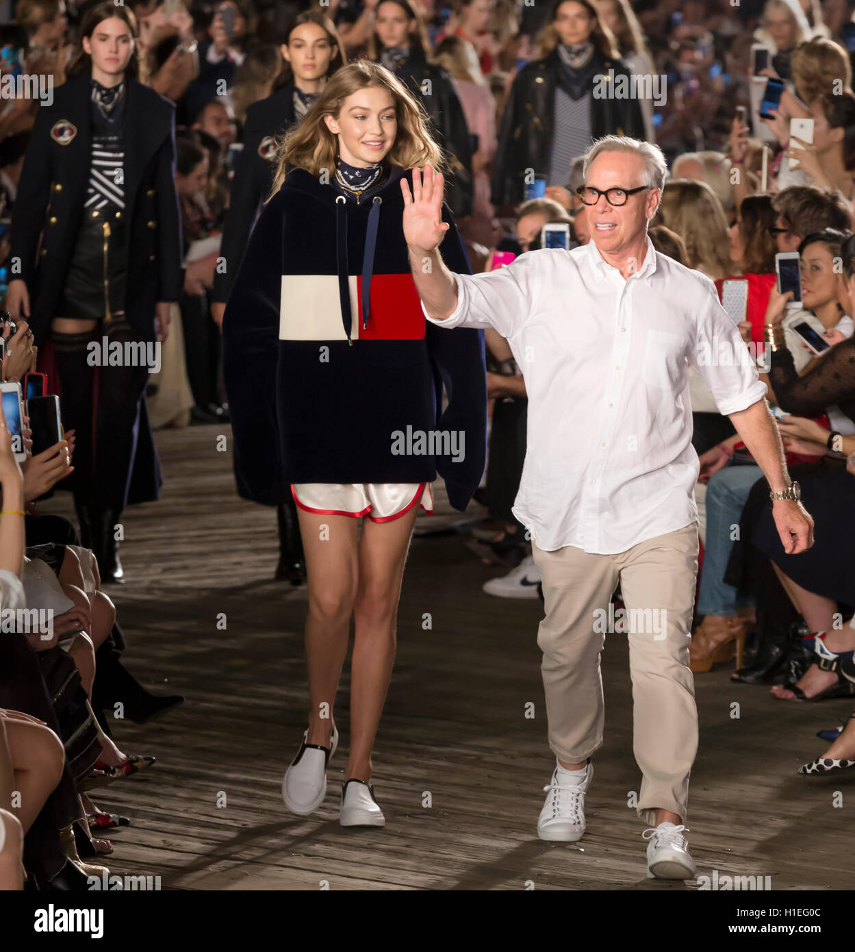 2de2435e NEW YORK, NY - SEPTEMBER 09, 2016: Gigi Hadid and designer Tommy Hilfiger