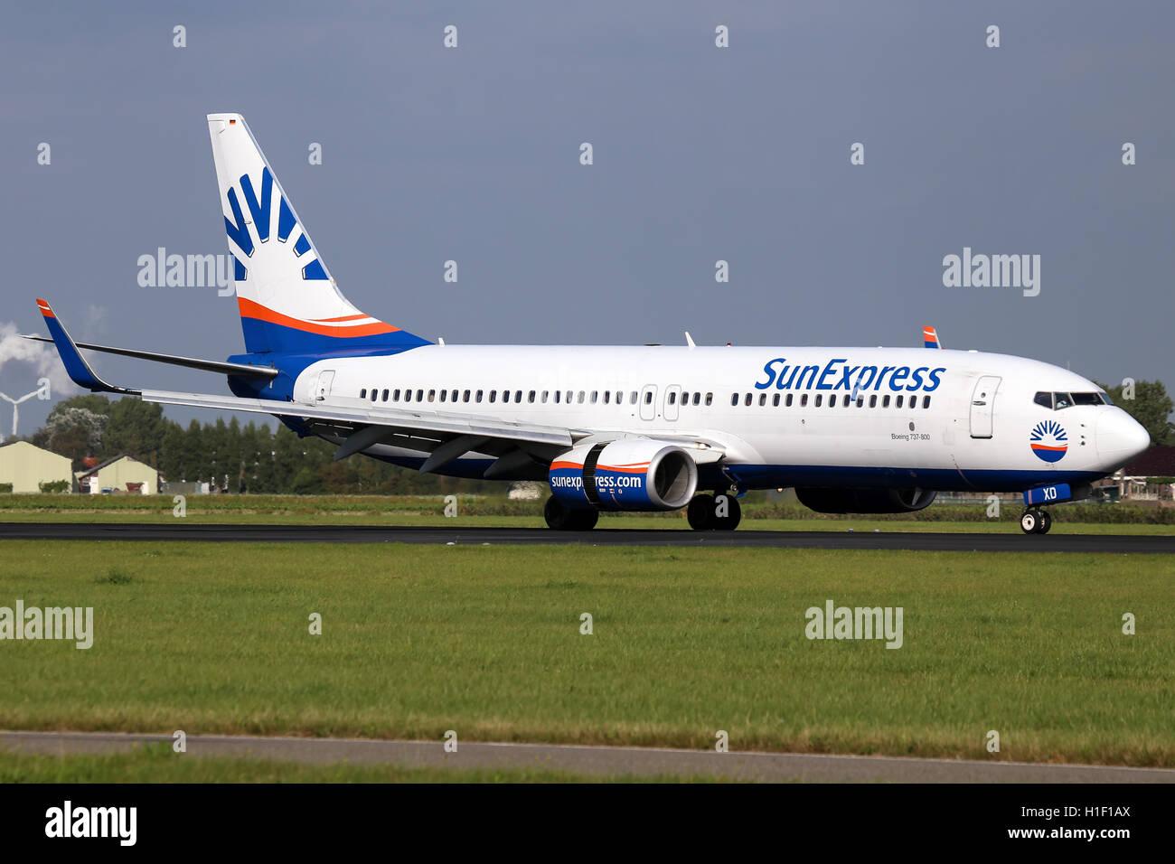 SunExpress Deutschland Boeing 737-800 touches down on runway 18R at Amsterdam Schipol airport. - Stock Image