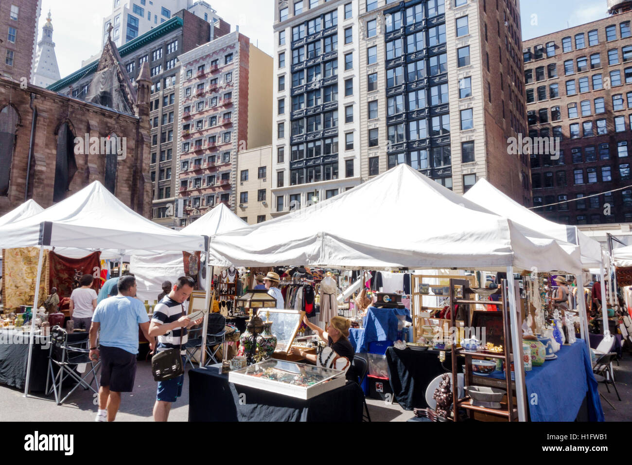 Manhattan New York City NYC NY Chelsea Chelsea Flea Market weekly open-air  market shopping antiques collectibles tent vendors booths stalls Asian woma