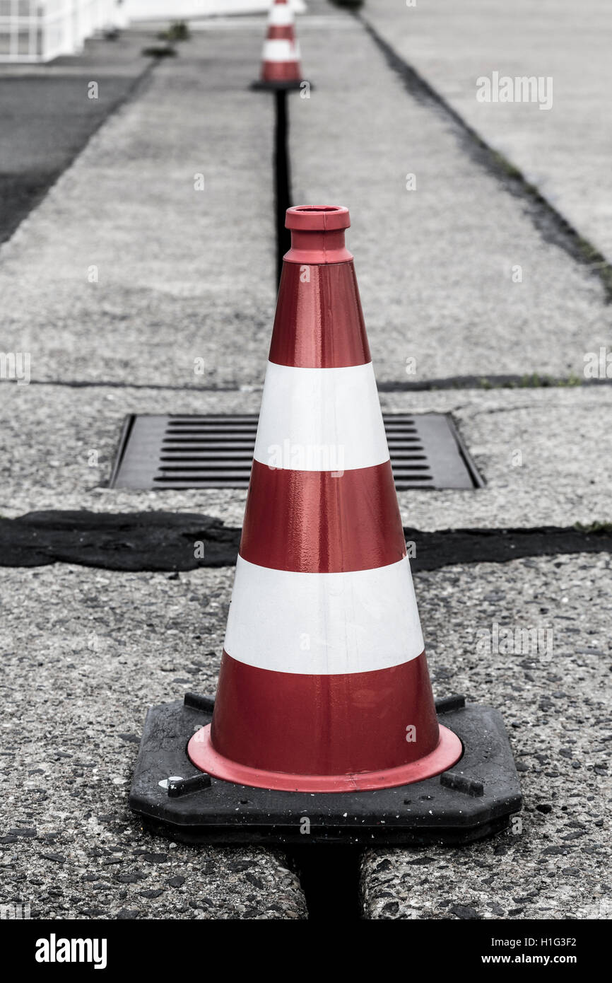 red and white traffic cone shoot on the Tempelhofer Feld, Berlin - Stock Image