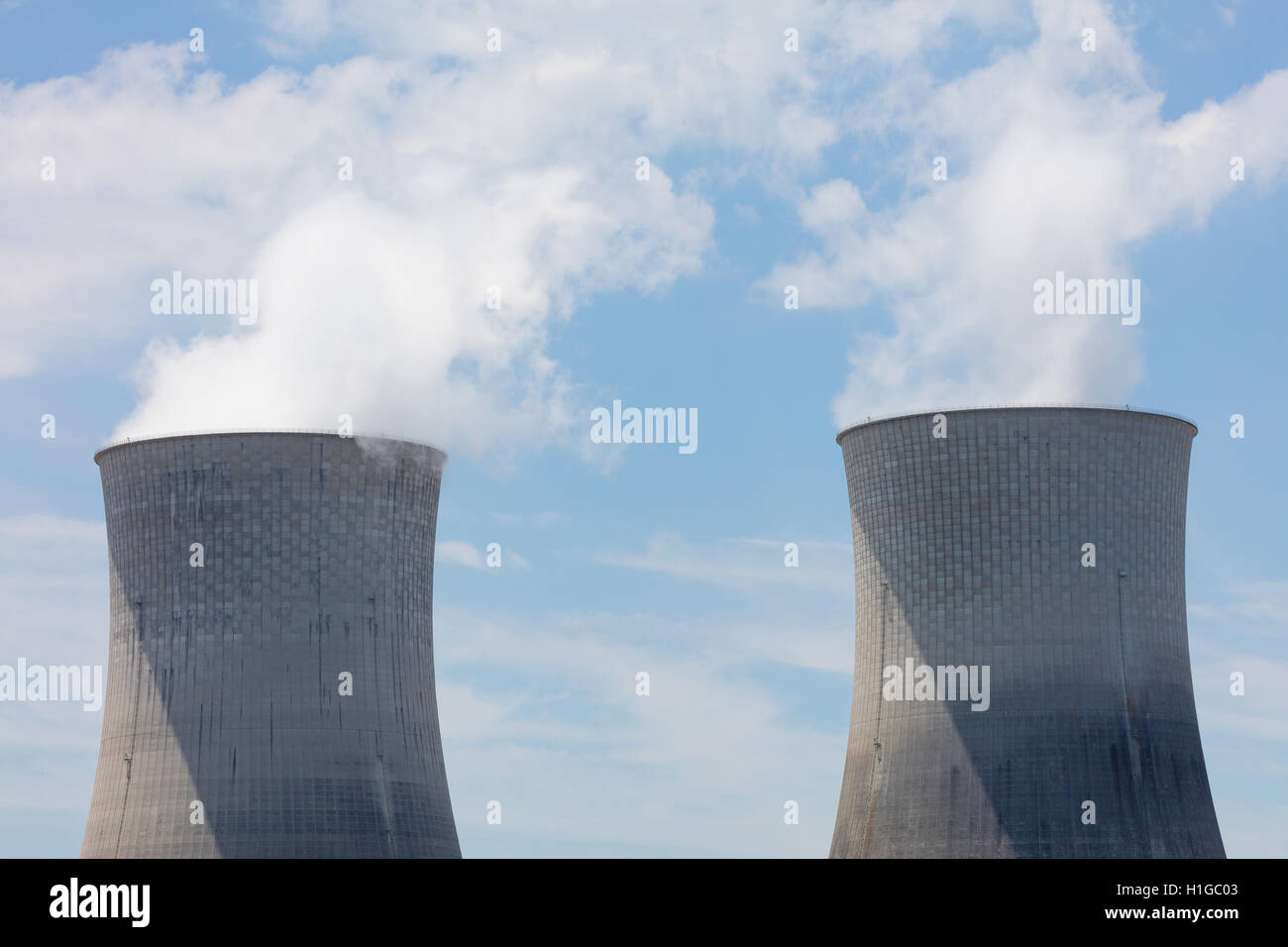 Two cooling towers at a nuclear power plant - Stock Image