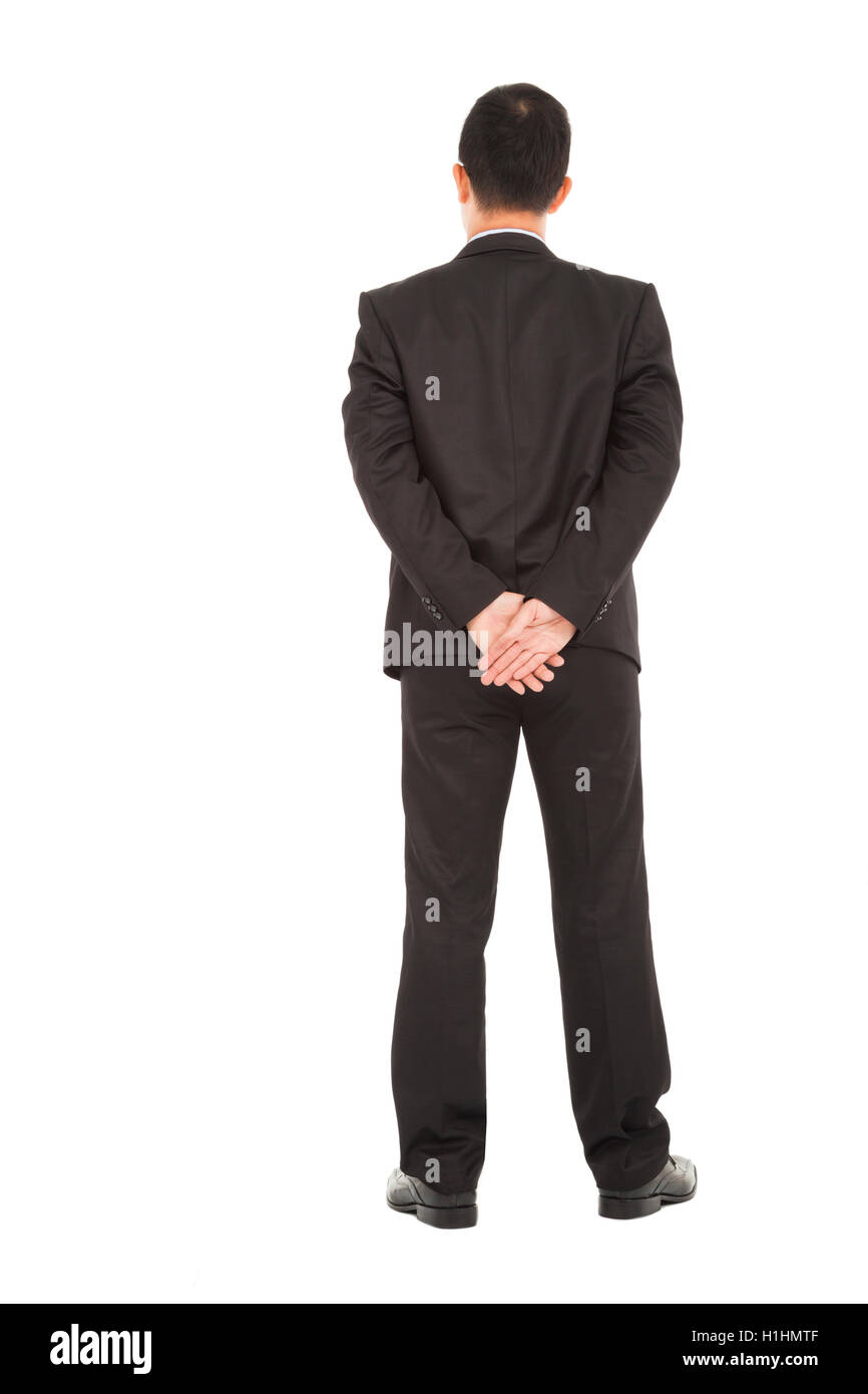 businessman standing back to looking forwand - Stock Image