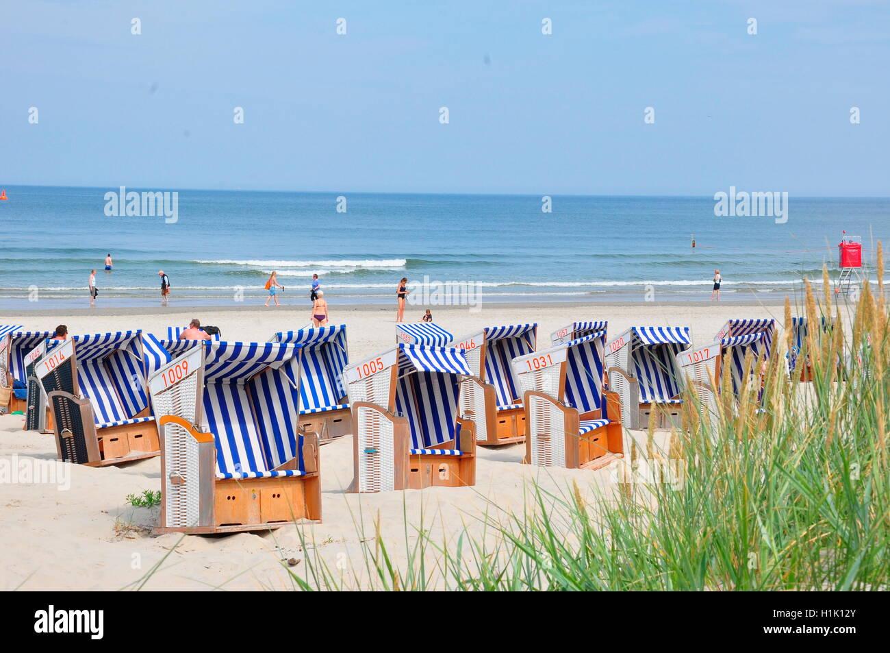 Strand, Sommer, Strandkoerbe, Urlaub, Nordsee, Norderney, Wattenmeer, Deutschland Stock Photo