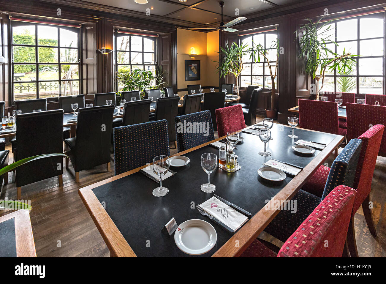 Restaurant tables laid ready for customers, Cardiff, Wales, UK - Stock Image