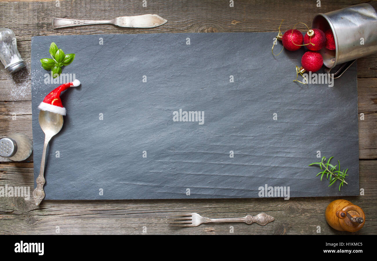 Christmas abstract culinary background on old retro black stone - Stock Image