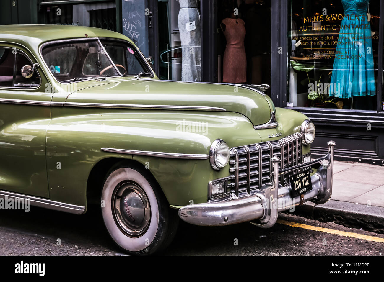 960fd0ac286bc Classic Green Car in Front of Vintage Shop London Stock Photo ...